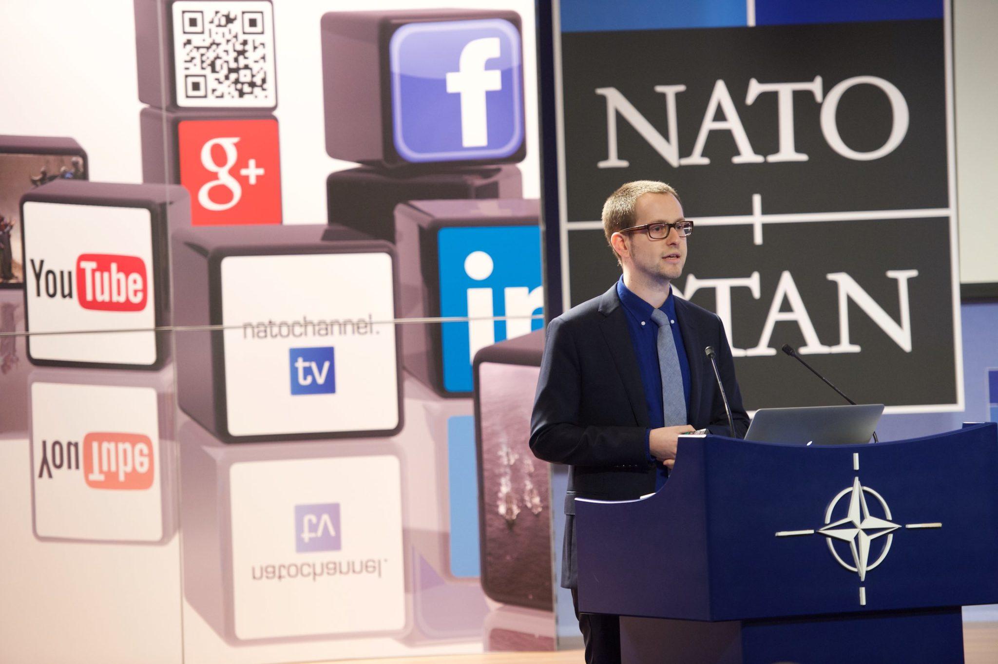 Brian Honigman speaking at NATO